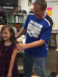 Mr. Beck and 3rd graders having fun with science!
