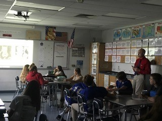 Mr Woodring and 8th grade discussing bias and the three little pigs.
