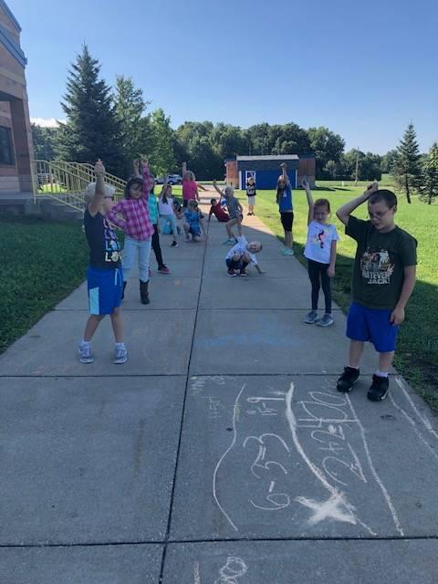 2nd Grade Math doing their math lesson outside - Miss Miller's class