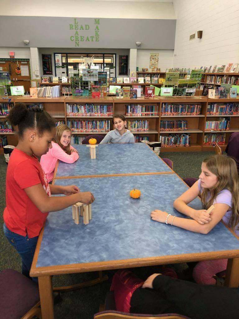 Mrs. Condren's class working on their pumpkin Jenga challenge!