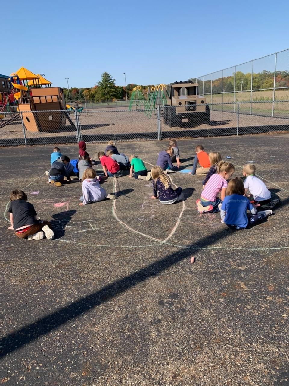 Mr. Kline's kindergarten class using a Venn Diagram to compare birds to bats.
