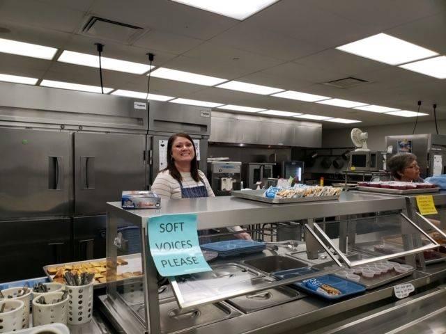 Mrs. McQuate helping serve 4th gr Grandparents Breakfast