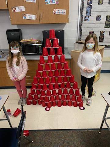 Kindergarten building with 99 cups on our 99th day!
