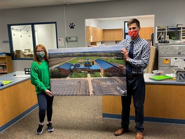 Rowan Cottrell presented Mr. Brightbill a photo of our school taken by her drone.